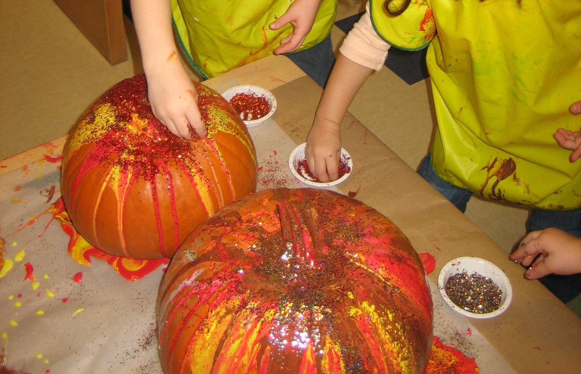 Pour painting pumpkins and glitter.