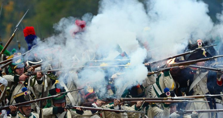 People dressed as Napoleonic soldiers fire their arms as they stage the Battle of Nations in Markkleeberg near Leipzig, Germany, 20 October 2013. More than 6,000 participants reenact the battle of 1813 between the armies of Russia, Prussia, Austria and Sweden against Napoleon's French and Saxonian troops. The Battle of Nations, fought 16 to 19 October 1813, resulted in a key defeat of Napolen's troops.