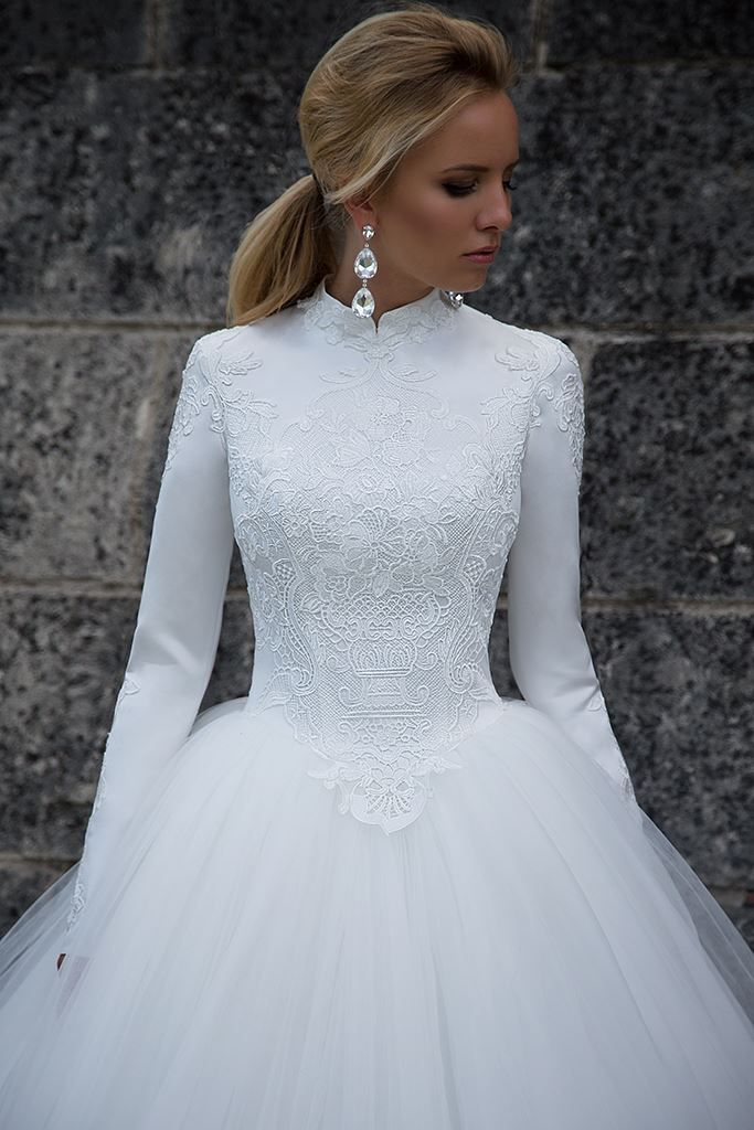 Conservative wedding dress with long sleeves and lush tulle skirt ...