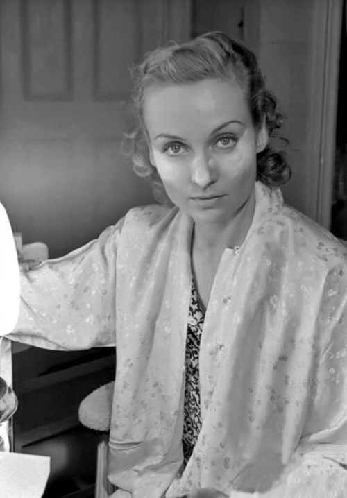 Carole Lombard at work — not acting, but getting ready to act, or just go out into the world.