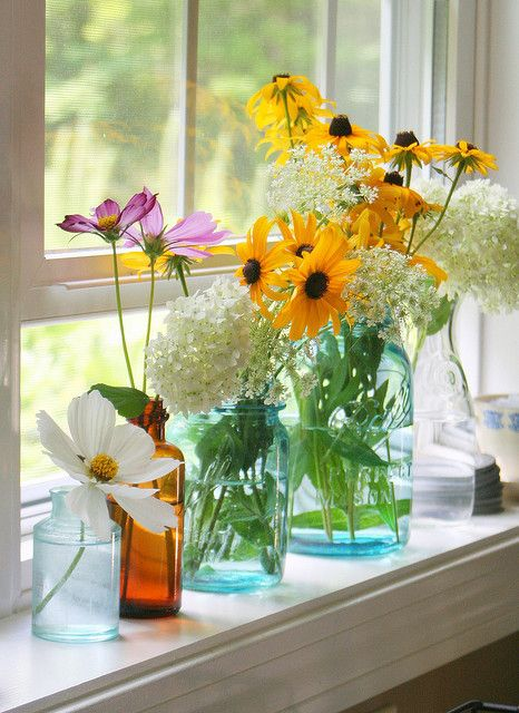 Flowers in diferent bottles all over the house.