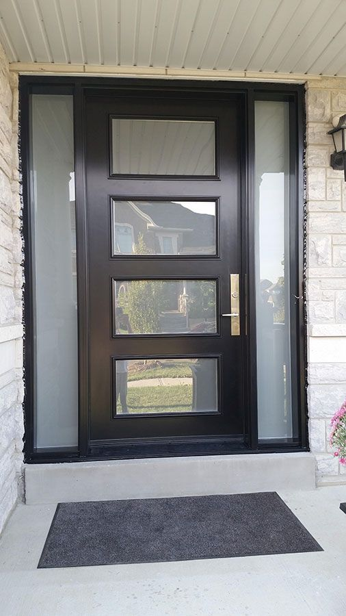 modern exterior door with multi point locks 4 door lites and 2 side lites installed