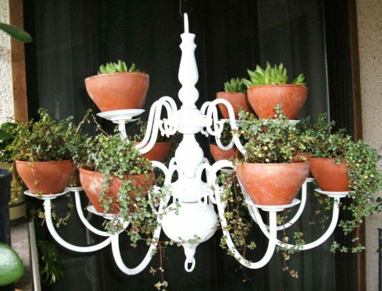 Morph an old light fixture into the most beautiful, whimsical outdoor planter