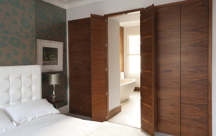 Wardrobes with secret door through to en suite bathroom for Master bedroom with ensuite and walk in wardrobe