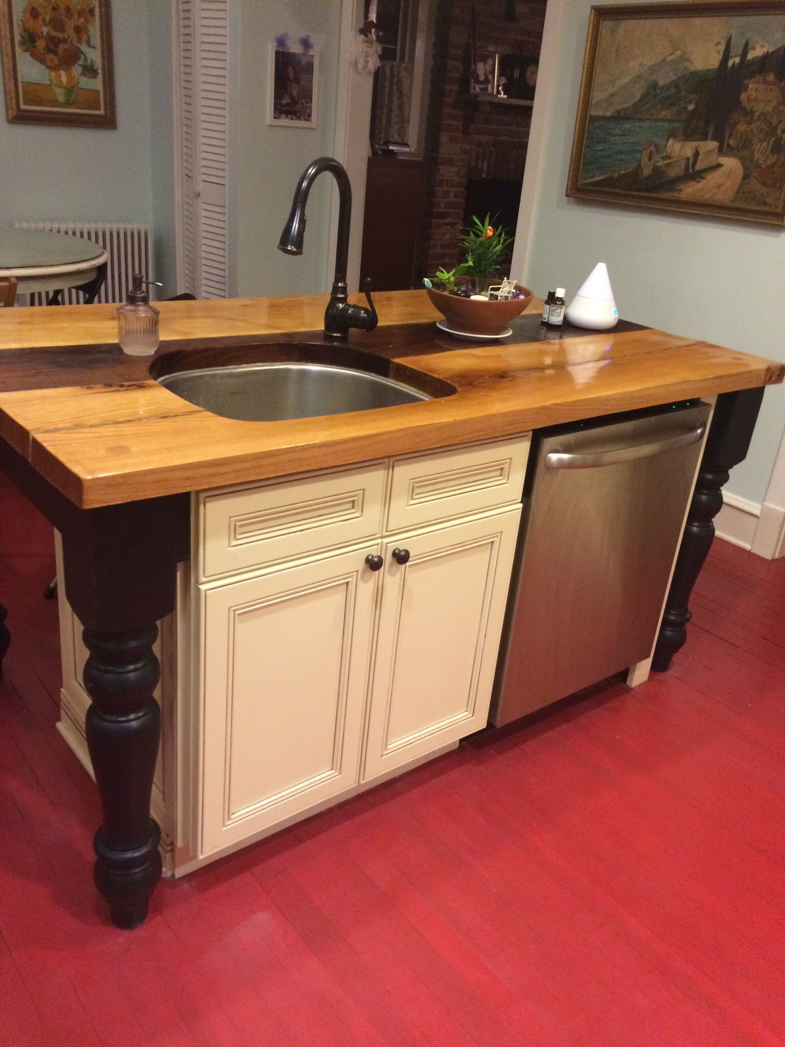 This custom wood top kitchen island with sink and