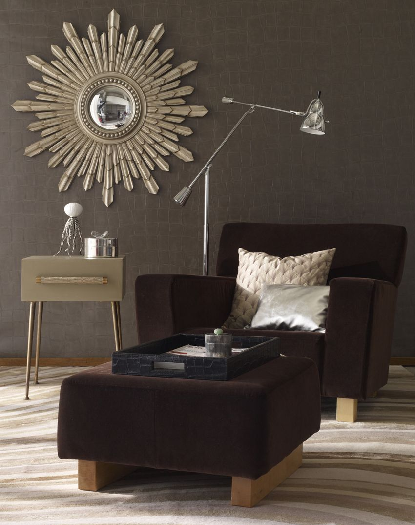Hollywood Glamour - Armchair, designed by Bjorn Trädgårdh of Svensk Tenn.  Pillows in silver leather and beige fabric both ROOM, side table by Oscar & Clothilde, steel mirror by Laura Ashley.  Floor lamp Slettvoll.  Hand knotted silk rug by Paul Smith, The Rug Company.