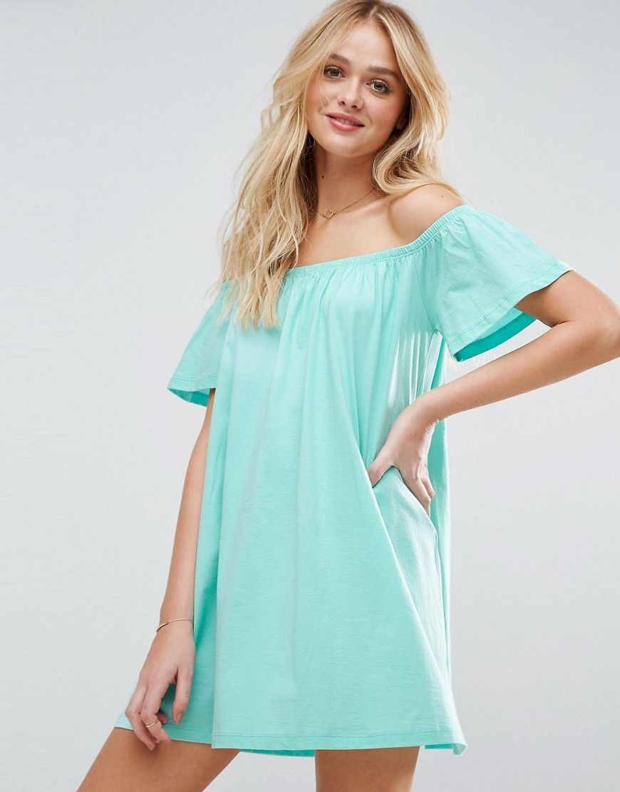 Buy it now. ASOS Off Shoulder Mini Dress - Green. Dress by ASOS Collection, Lightweight jersey, Bardot neck, Relaxed fit, Machine wash, 100% Cotton, Our model wears a UK 8/EU 36/US 4 and is 178cm/5'10 tall. ABOUT ASOS COLLECTION Score a wardrobe win no matter the dress code with our ASOS Collection own-label collection. From polished prom to the after party, our London-based design team scour the globe to nail your new-season fashion goals with need-right-now dresses, outerwear, shoes and…