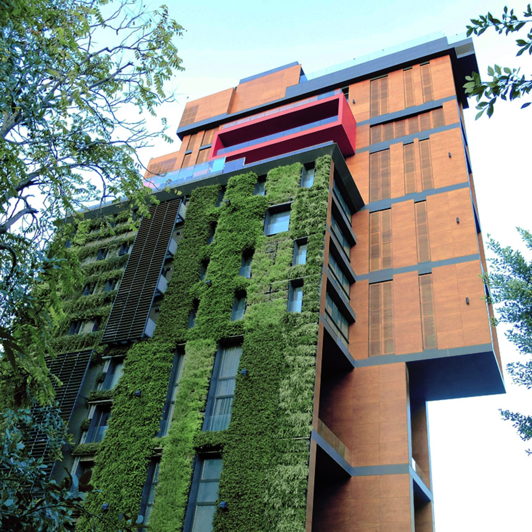 Village Green East Apartments: A Vertical Garden Contrasts With Traditional Timber And