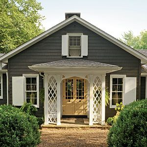 This cottage was painted in Sherwin Williams Black Fox.