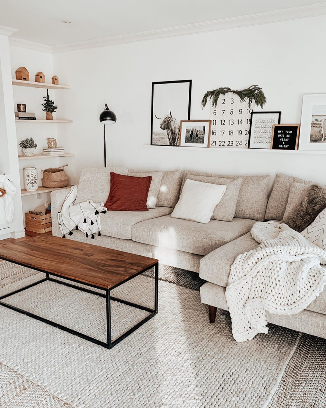 """B R I T T   H A V E N S's Instagram profile post: """"Merry Christmas Eve Eve! We are loving our new living room and had so much fun decorating this space for the holidays! @urbanbarn has the…"""""""