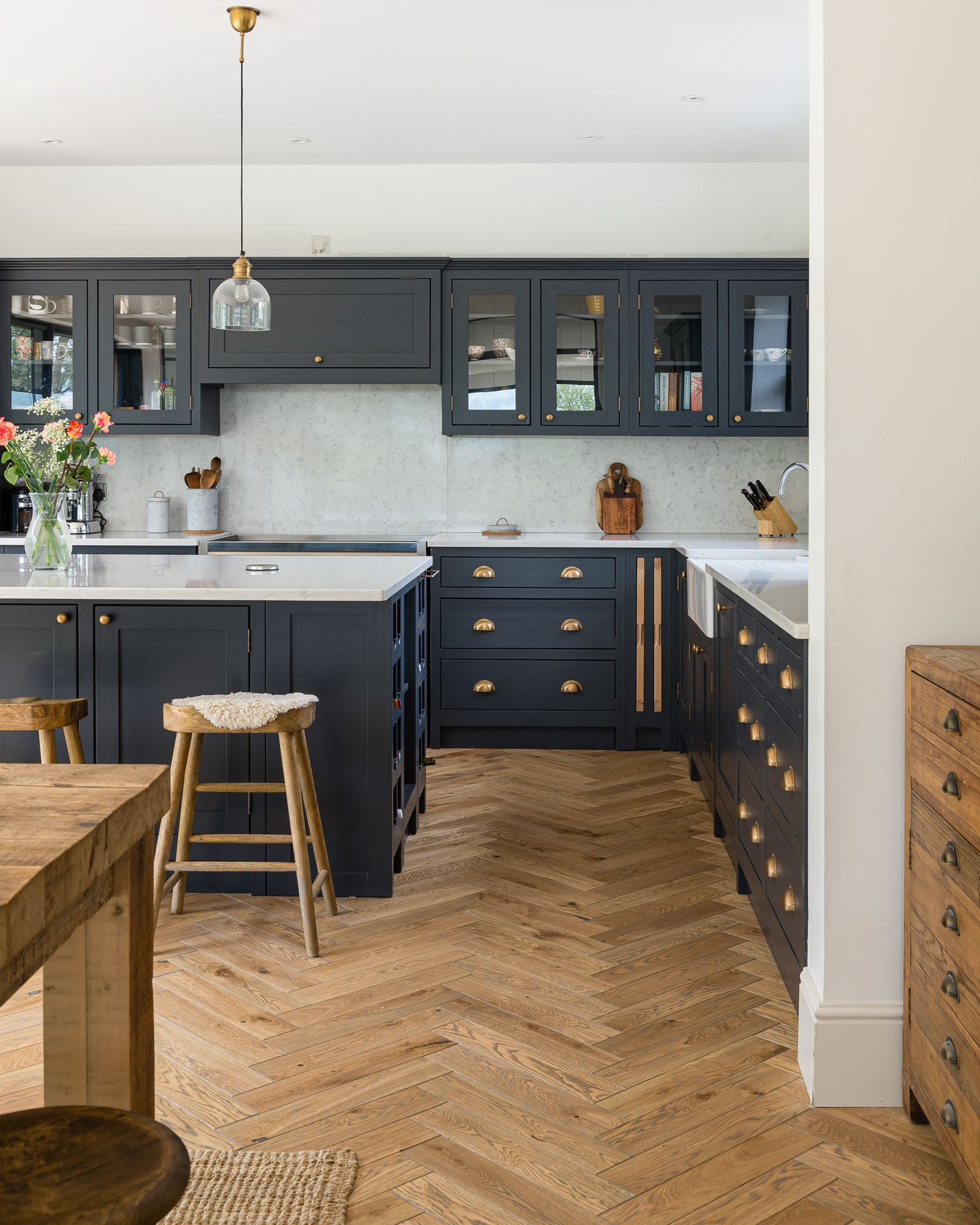 The stunning herringbone flooring and our bespoke cabinetry make this one of our most popular kitchens to date!  Classic dark tones throughout the kitchen compliment the warm oak flooring and brass cabinet handles and fittings.  So lovely.