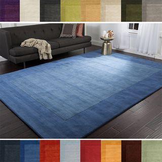 Hand Loomed Risor Solid Bordered Wool Area Rug 7 6 X 9