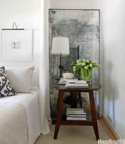 Place a large standing mirror behind a nightstand to reflect the lamp's light and make the room look bigger #bedroom