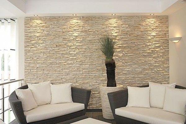 Interior stone veneer cream stone wall black sofas white - False wall designs in living room ...