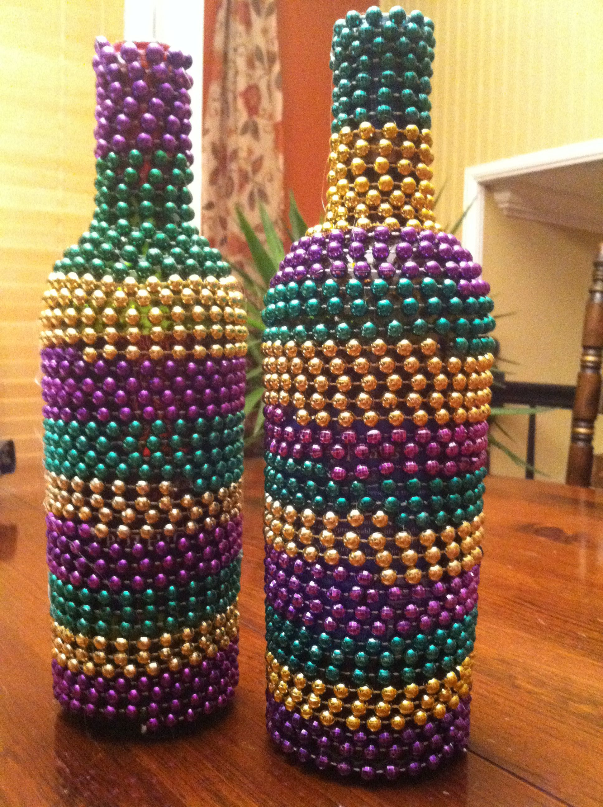 Got mardi gras beads put them to use and decorate your for Ways to decorate wine bottles
