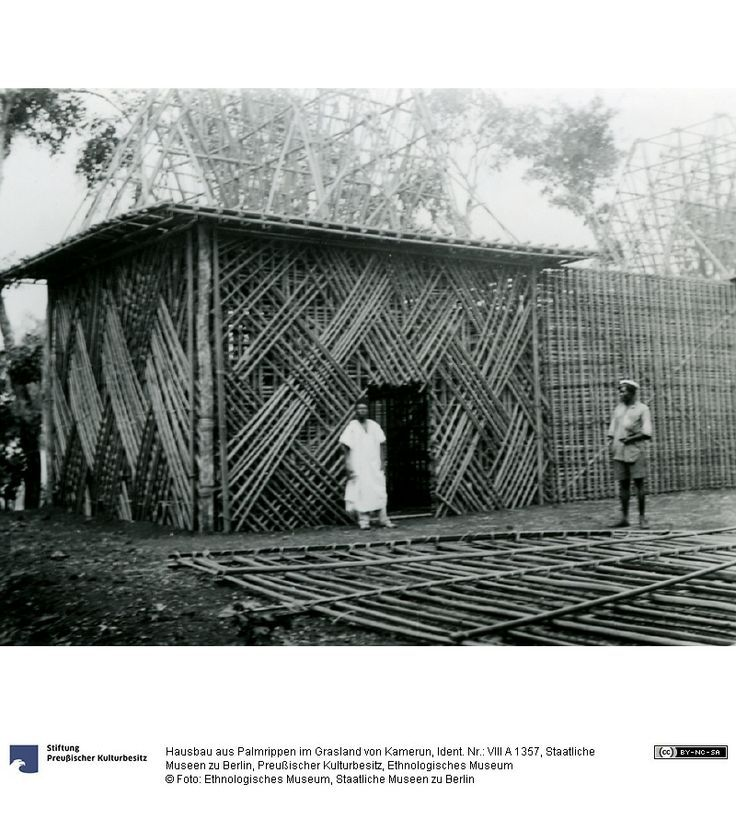 House being built of prefab sections, early 20th c #Cameroon #African architecture #African house