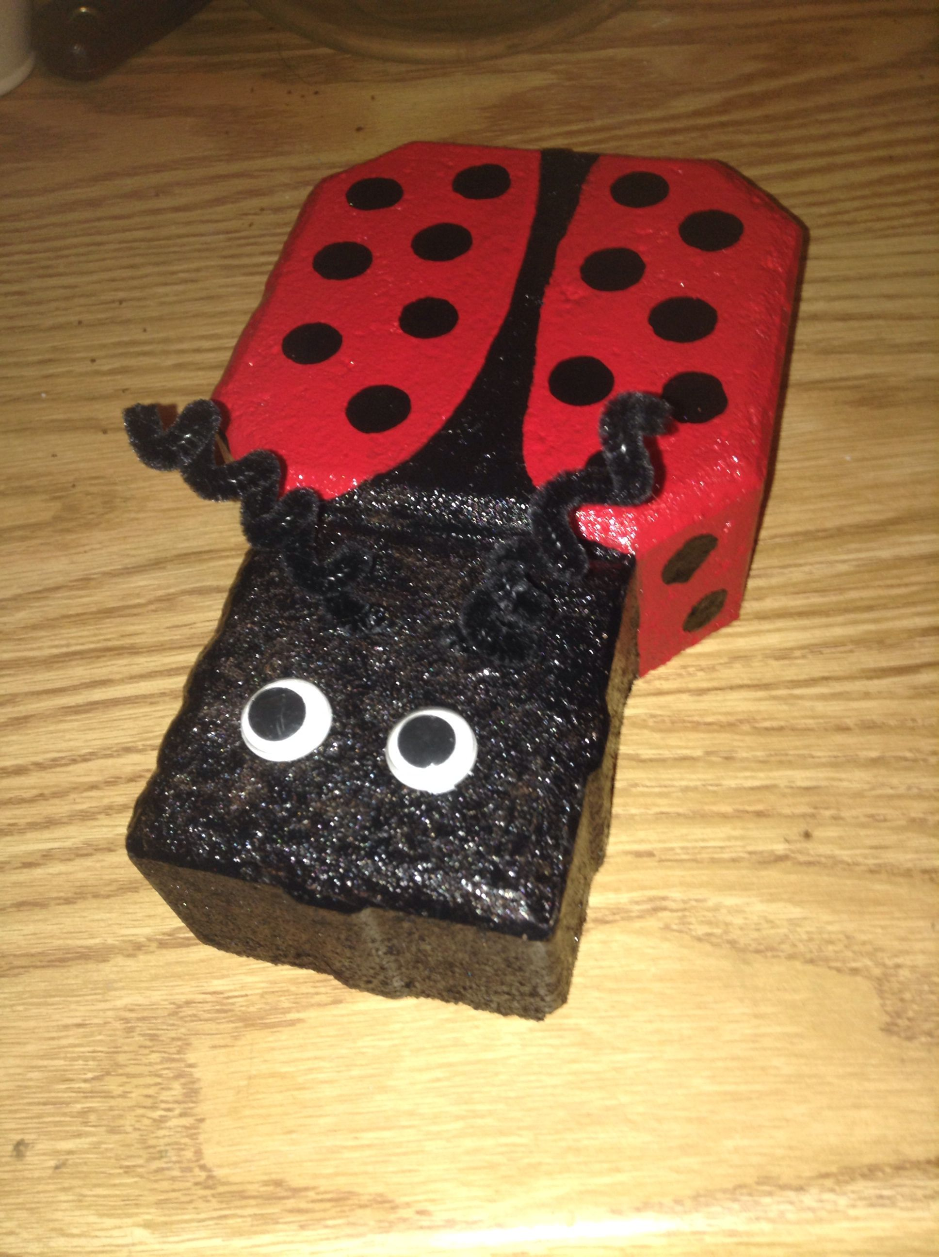 I painted a ladybug on a keyhole paver. Ready for the garden.