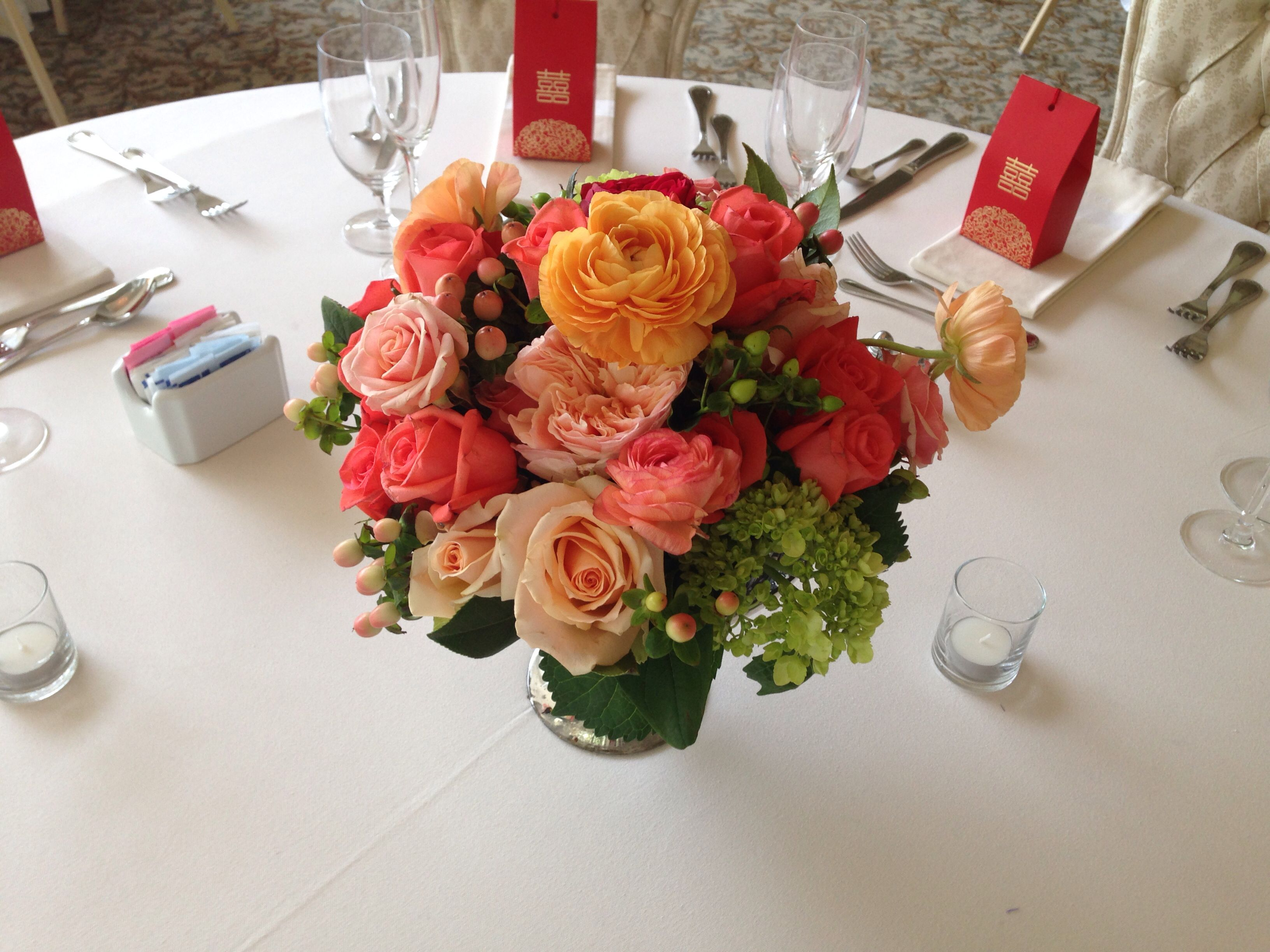 Peach, coral and green centerpieces