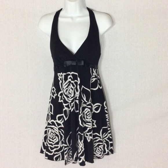 Forever 21 Halter Dress Upper Halter Portion is Black, Lower Portion is Black/White Floral Print Cute and Flowy With Flat Black Bow on Front Waist Forever 21 Dresses Mini
