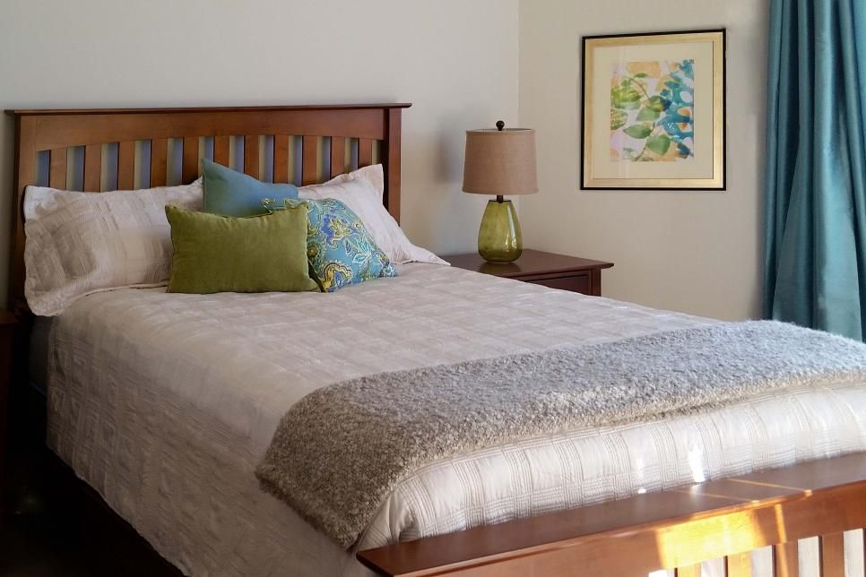 This Neutral Traditional Guest Bedroom Features A Wooden Shaker Style Headboard And Footboard Along With