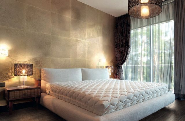 Huge tiles placed on the wall of the bedroom Decor Ideas