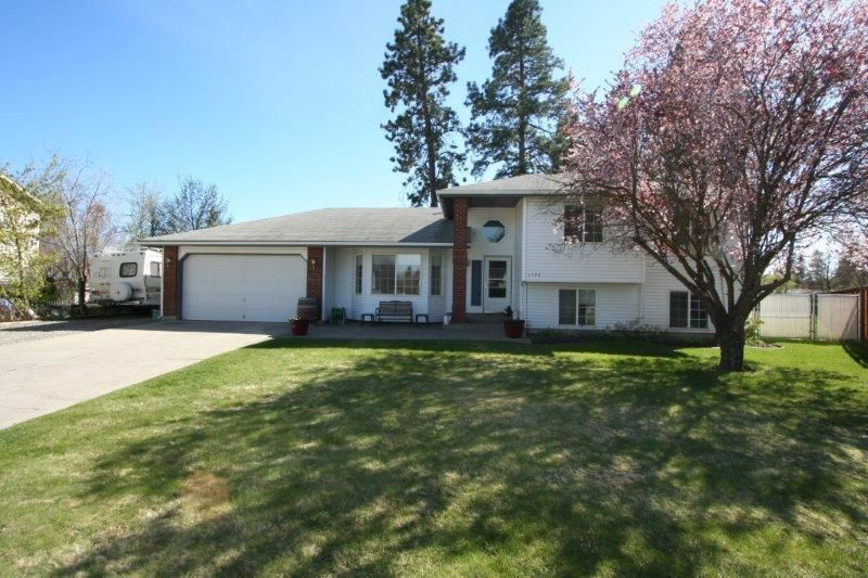 ROOM FOR A SHOP! WOW! Over 2200 sq.ft. one owner home on nearly 1/2 acre on a quiet culdesac in Post Falls. 3 bed and 2.5 baths, lovely family room, spacious main level, fenced and landscaped lot with sprinklers, A/C and clean as can be! RV Parking and over sized 2 car garage with work space and so much more! Plenty of room for a shop! Expect to be impressed!