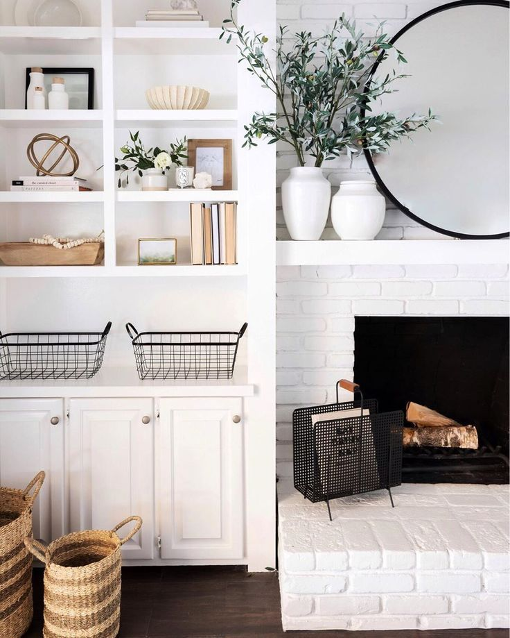 modern farmhouse living room with white brick fireplace and open shelf styling #modernfarmhouselivingroom