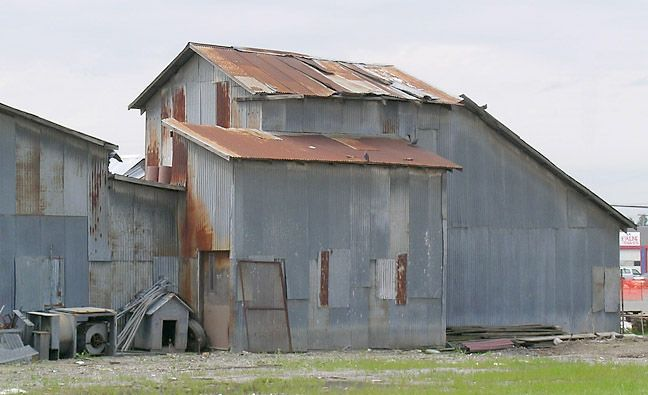 Corrugated metal industrial structures corrugated metal for Old barn tin ideas