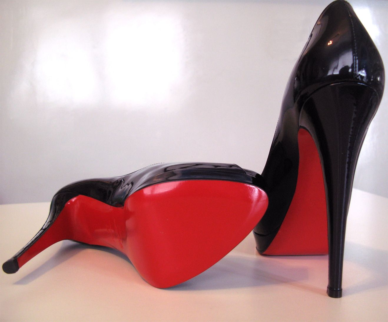 christian louboutin black high heels red soles