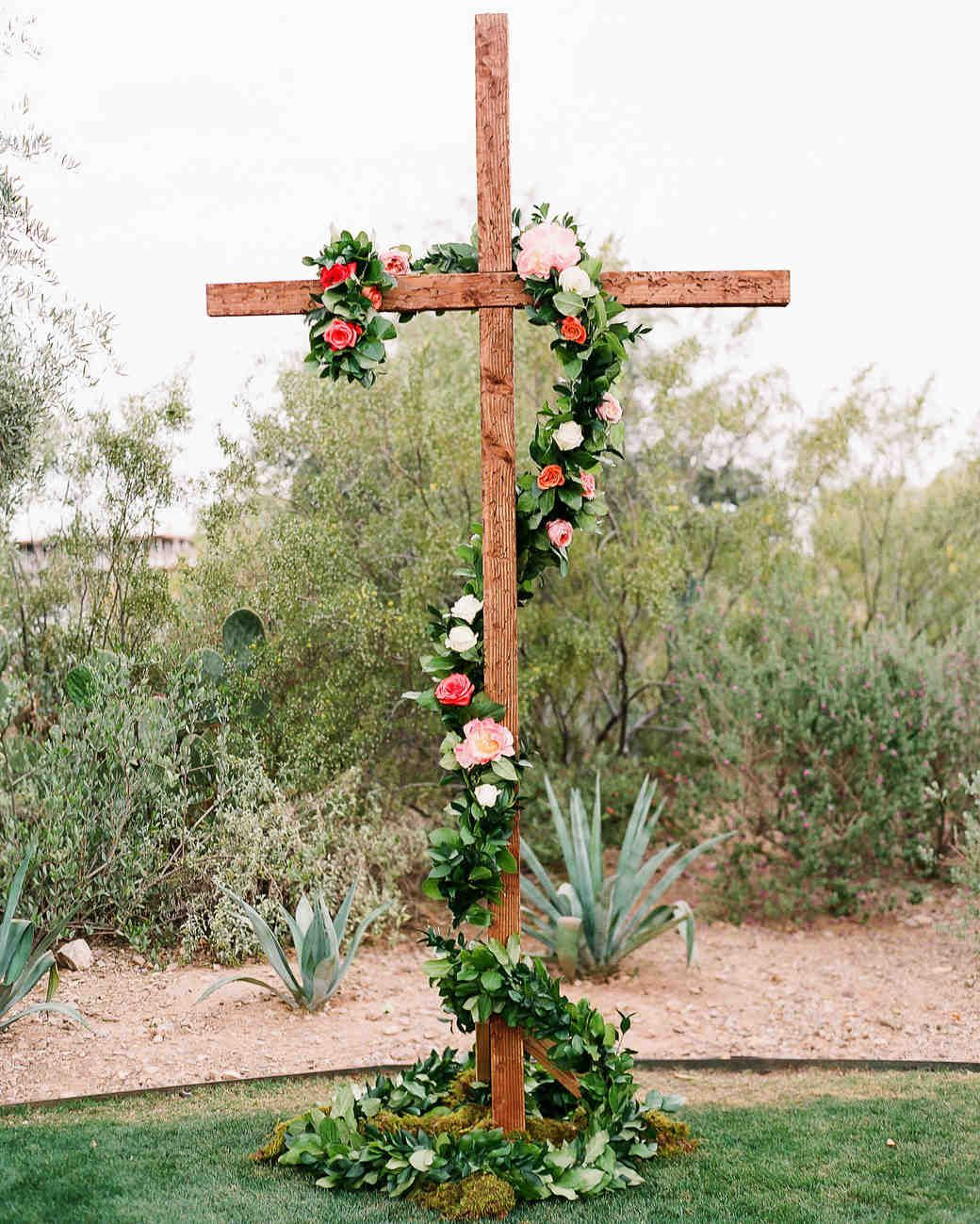 """A Bright Wedding in Arizona with Boho Touches   Martha Stewart Weddings - """"The free-standing cross belonged to a family friend and was the most amazing backdrop to our couple whose relationship grew strong through their faith,"""" Hallie explains of incorporating the structure that was decorated with roses, peonies, and trailing greenery."""