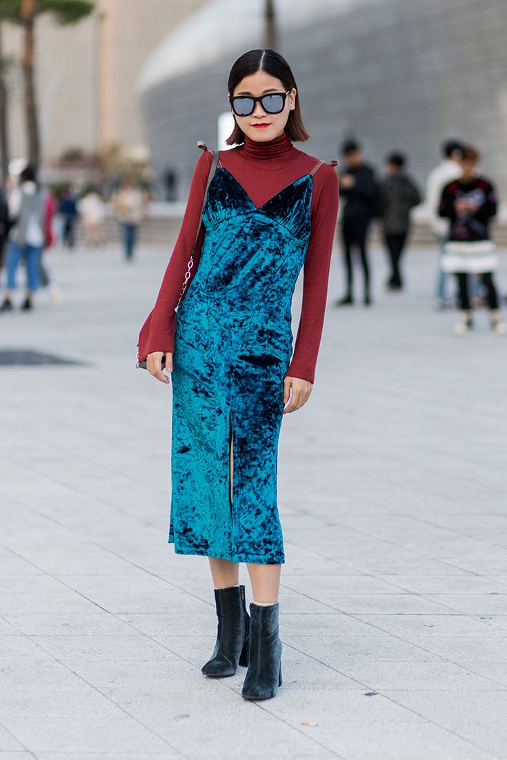 A crushed velvet slip dress spotted at Seoul Fashion Week becomes major (and autumn-friendly) when worn layered over a roll neck