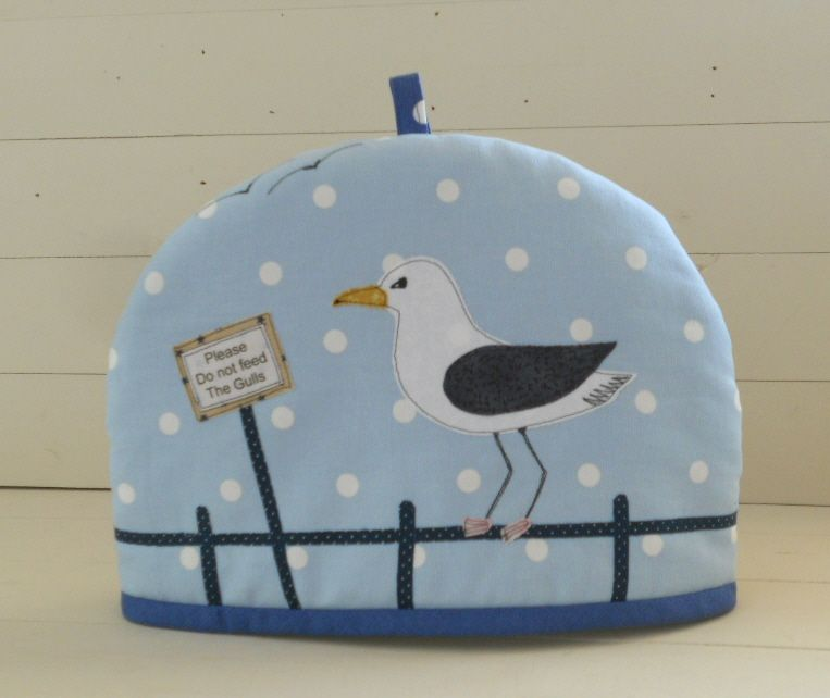 Wise Words On This Tea Cosy. Pale Blue Spot Cotton Fabric