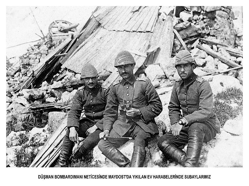 Ottoman officers sitting in front of debris of destroyed house in Maydos.WW1