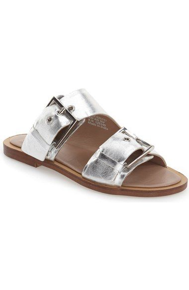 cf40abc8c31 A two-strap sandal embellished with bold buckles serves as an effortlessly  sophisticated casual essential.
