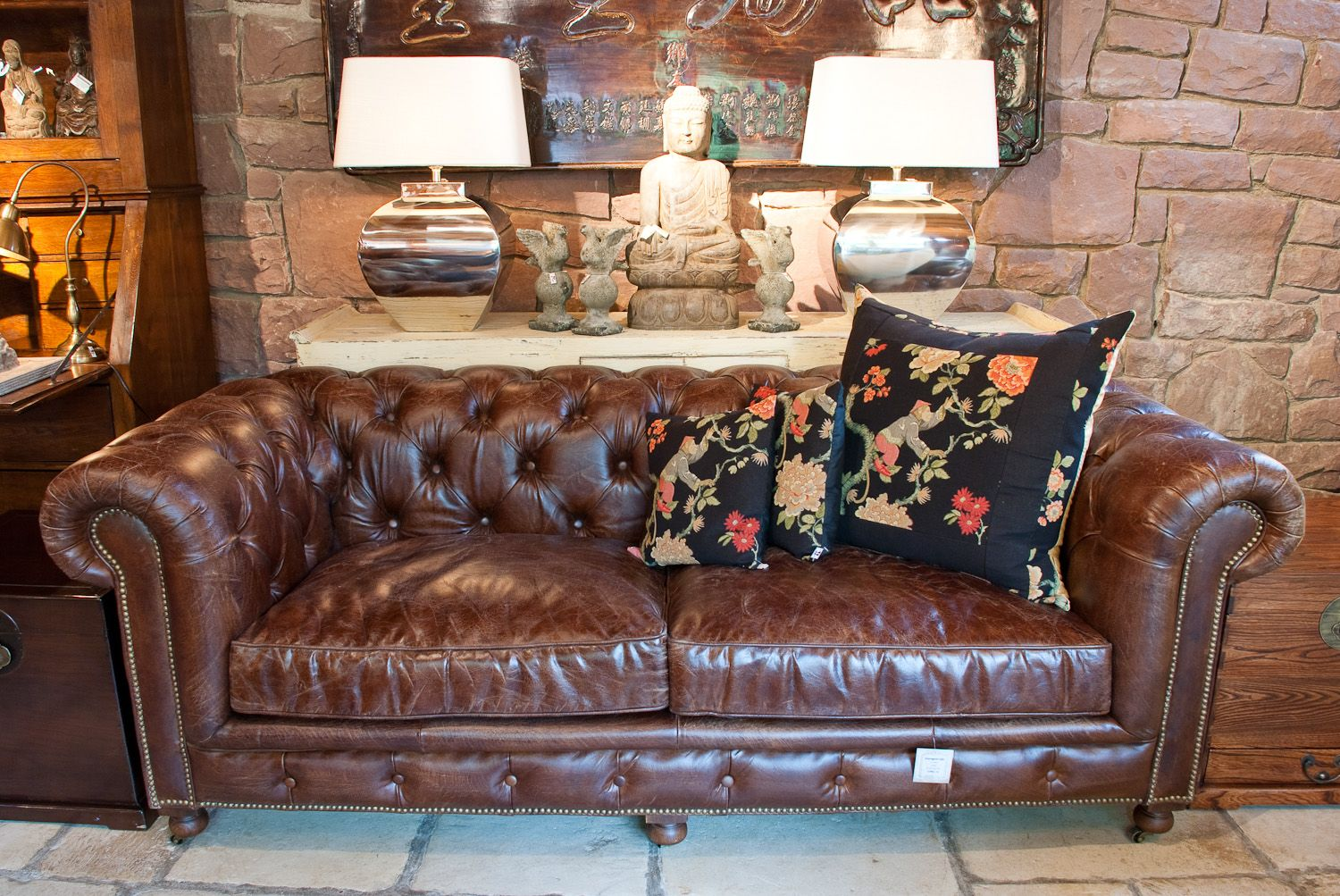 Dark Brown Leather Sofa With Floral Cushion Decorative Buddha Statue And Unique Table Lamp Brown Leather Sofa Dark Brown Leather Sofa Floral Cushions