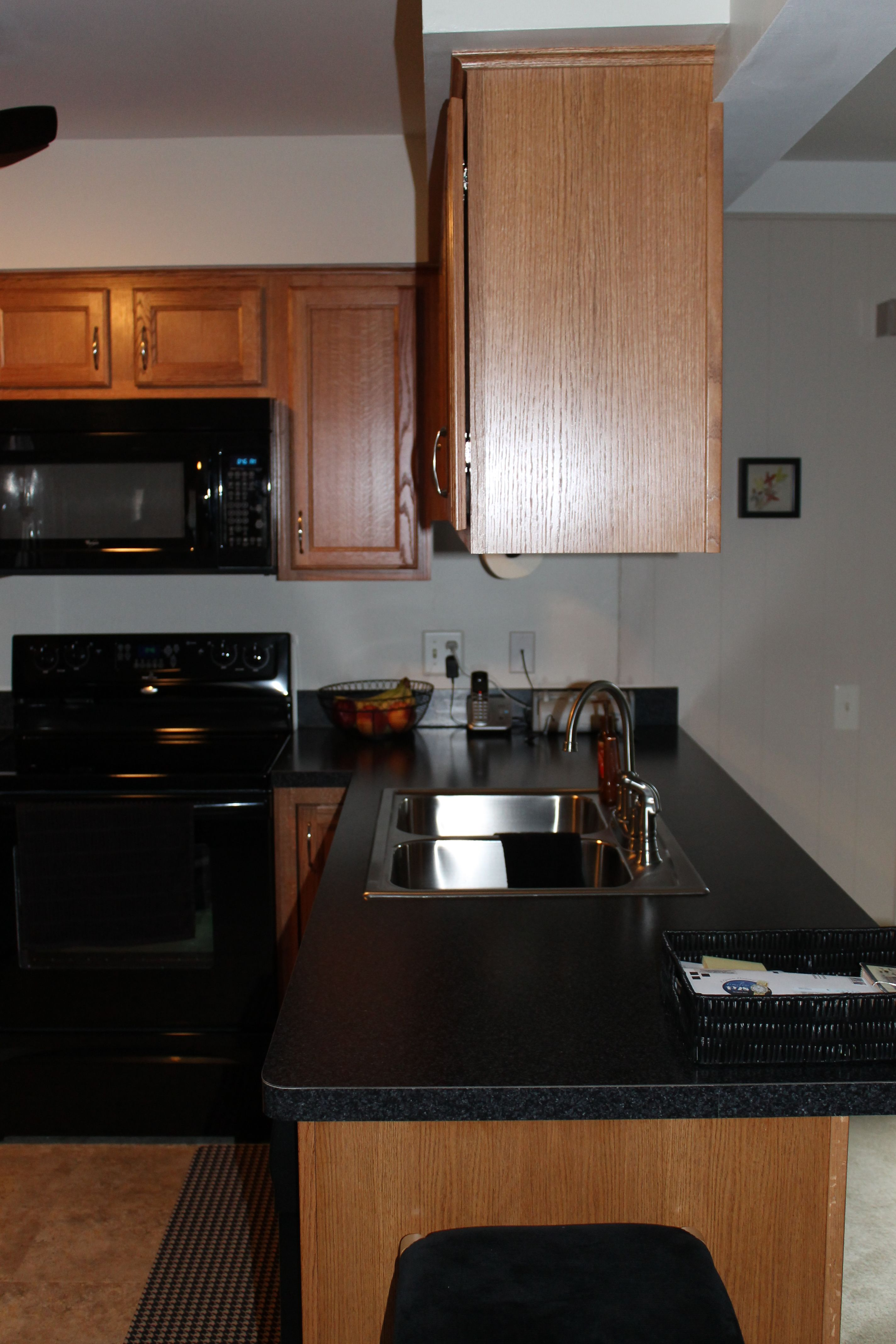 Medium, Light Shaker Style Cabinetry with Black Appliances and ...