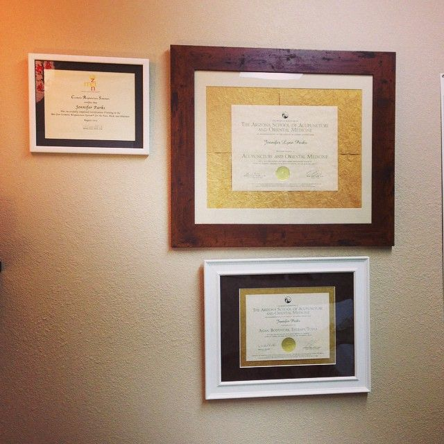 Jennifer's treatment room with her degree and certificates very nicely framed by Arizona Picture and Frame on Speedway. They look beautiful in the new treatment room. #framing #acupuncture #degree #creativeframing