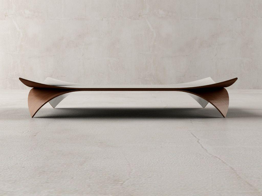 Cette Table Basse En Bois A Un Design Très Fin Qui Lui Donne Lu0027aspect De  Deux Feuilles De Papier Posées Lu0027une Sur Lu0027autre.