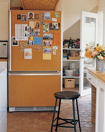 A corkboard-covered refrigerator.