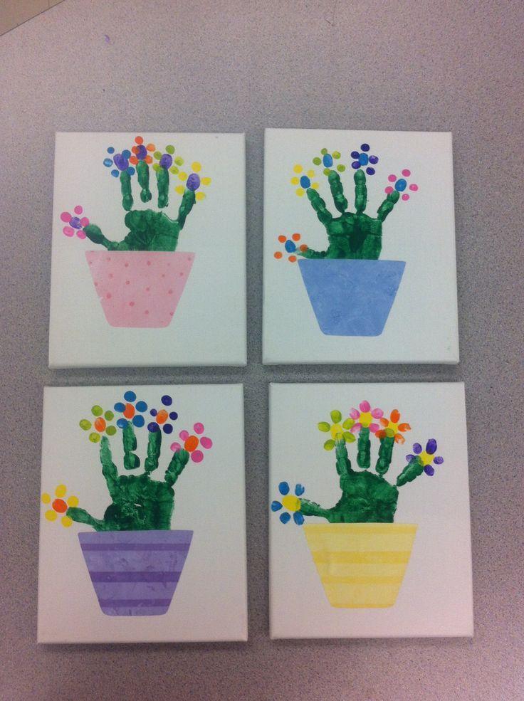 Handprint with fingerprint flowers on canvas. Flower pots were cut from scrapboo   #on #out #flowers # flowerpots #fingerabd #flowerpot