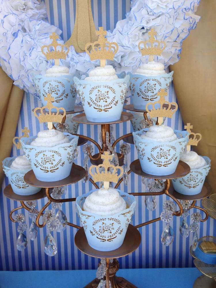 Royal blue and gold cupcakes at a baptism party see more