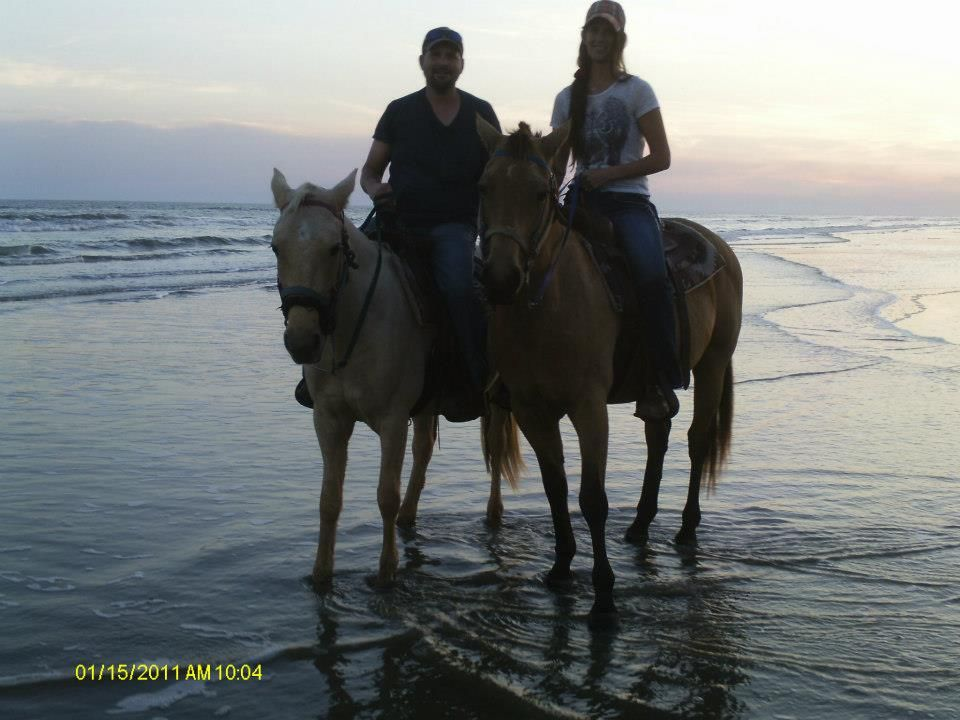 Ride horses on the beach with my Husband :)