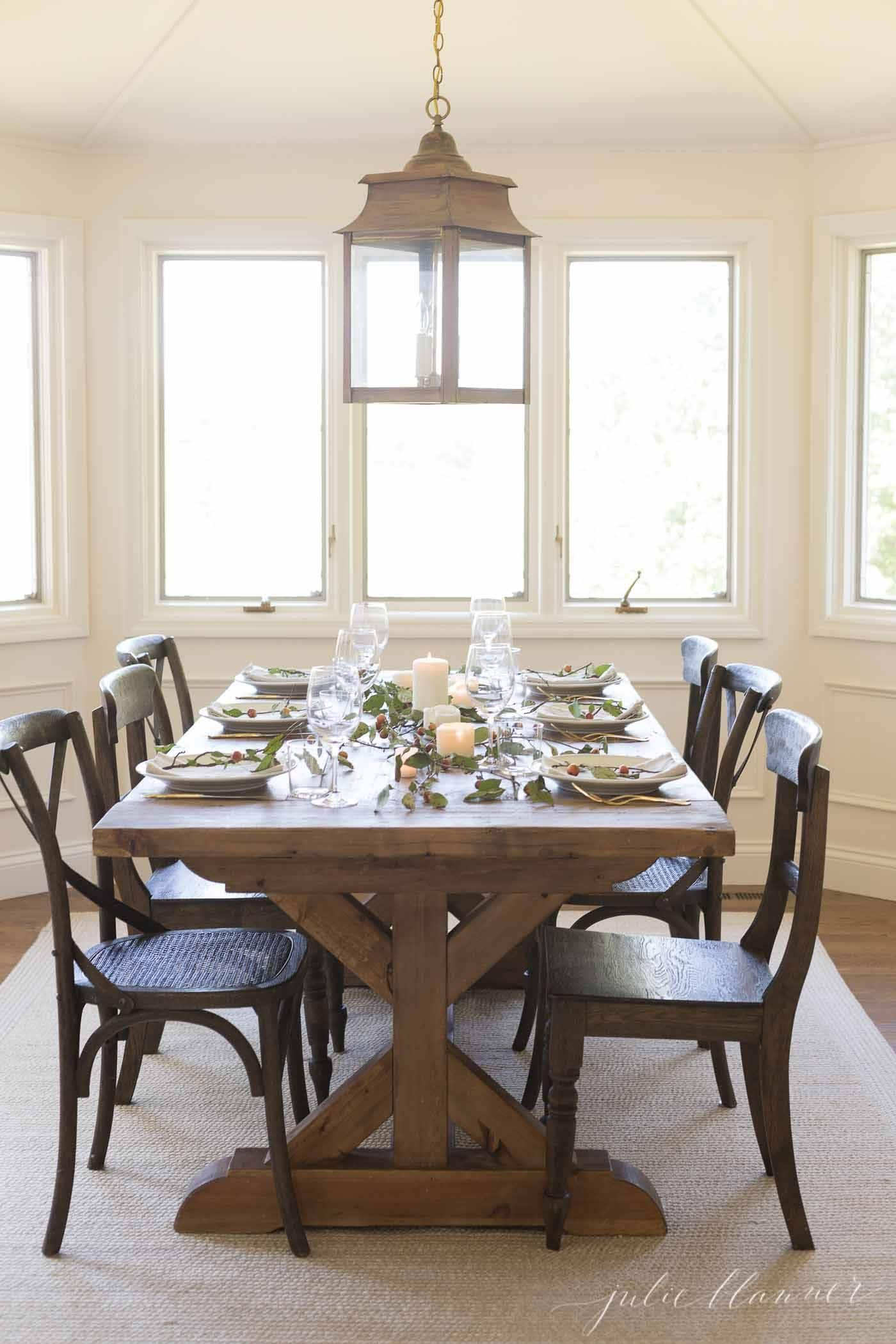 modern farmhouse dining room with lantern chandelier | downstairs in