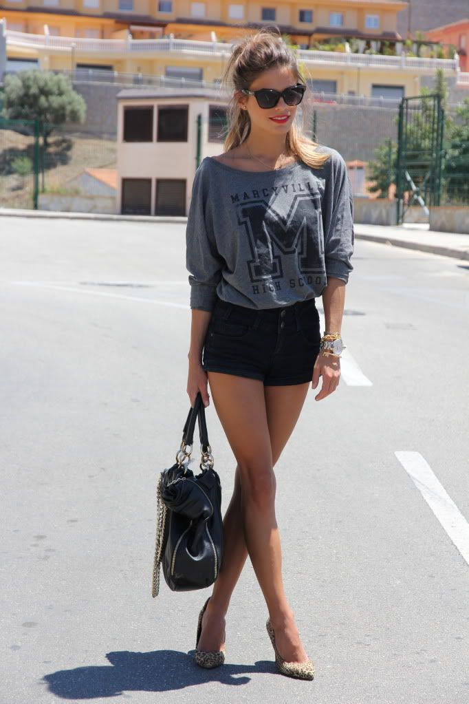 grey varsity sweater with black high waisted jean shorts