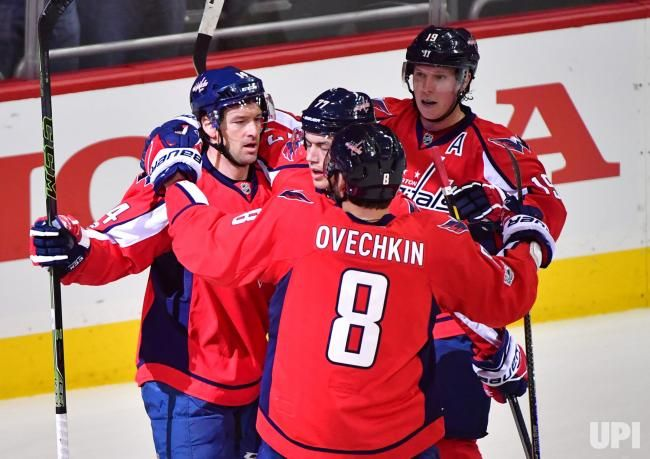 Washington Capitals right wing Justin Williams (14) celebrates with Alex Oveckhin (8) and other teammates after scoring against the Toronto…