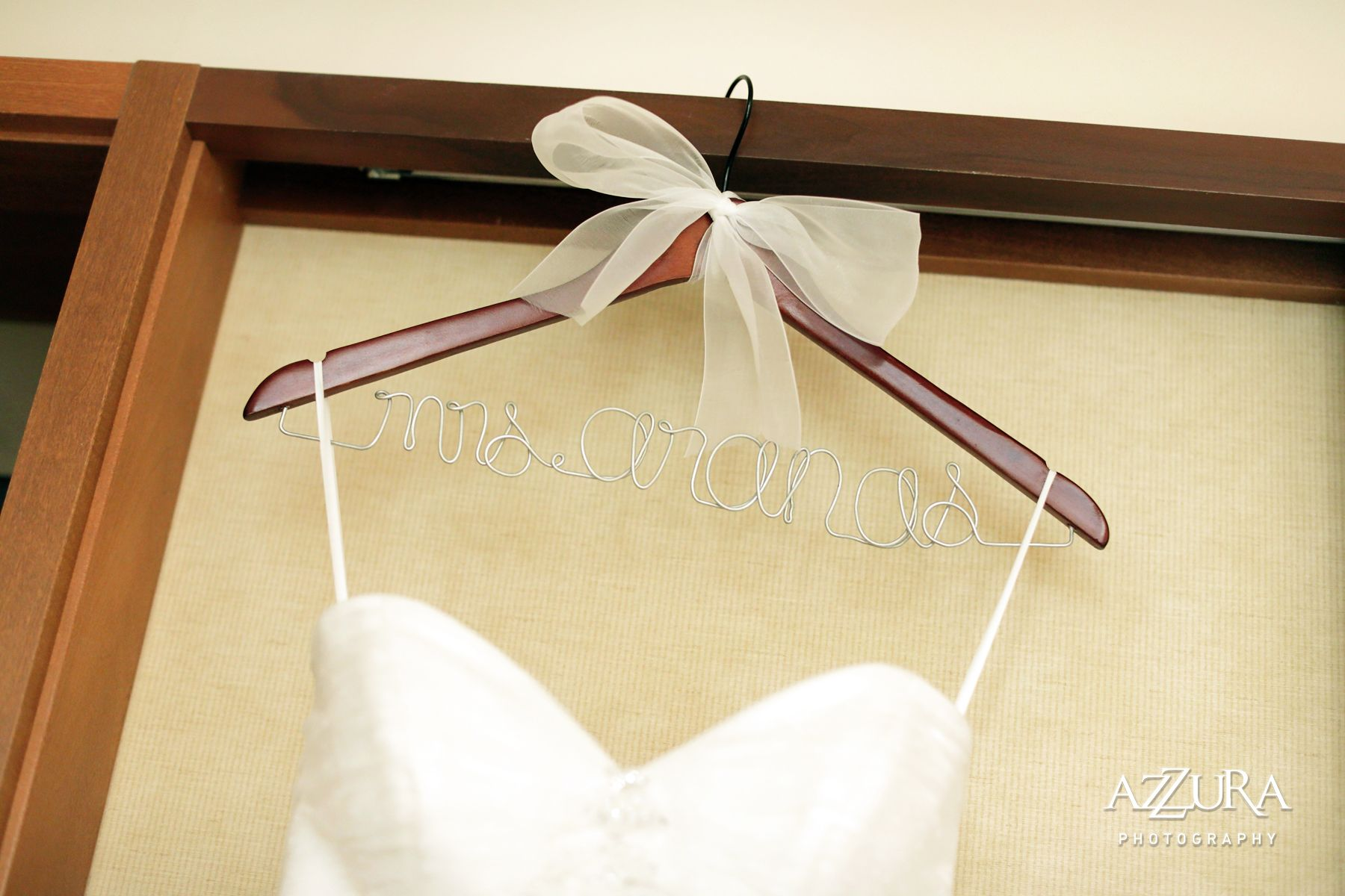 Custom wedding gown hangers are a cute touch