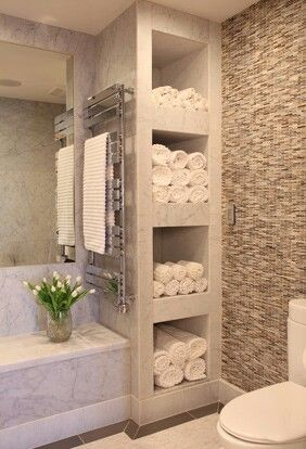 Great idea for use of extra space a small storage area for bath linens.