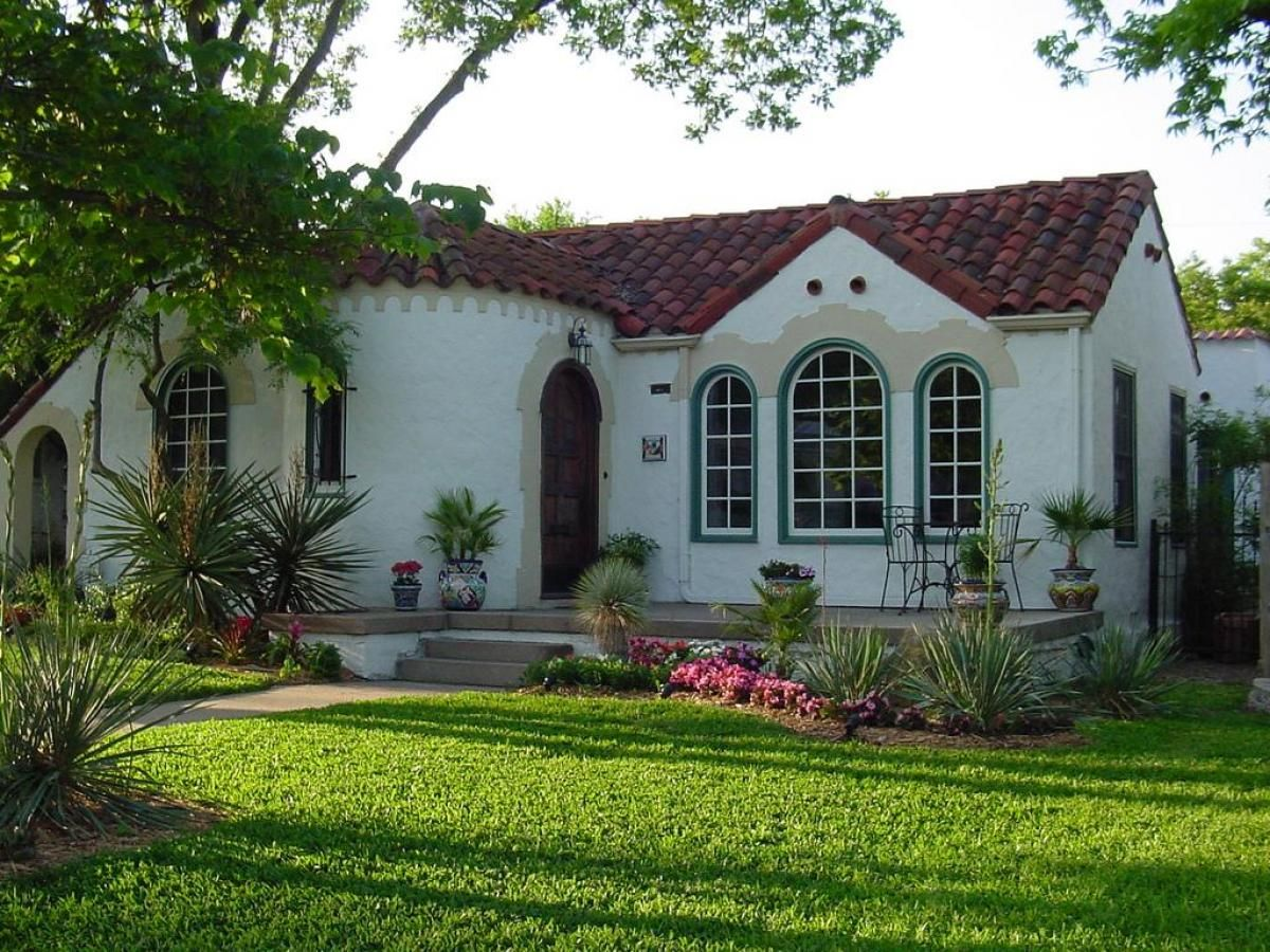 Green grass at frontyard garden at the small classic house for Spanish exterior design