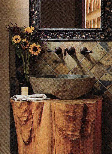 baño rústico, lavabo de piedra y tronco de madera como encimera - lavabos rusticos