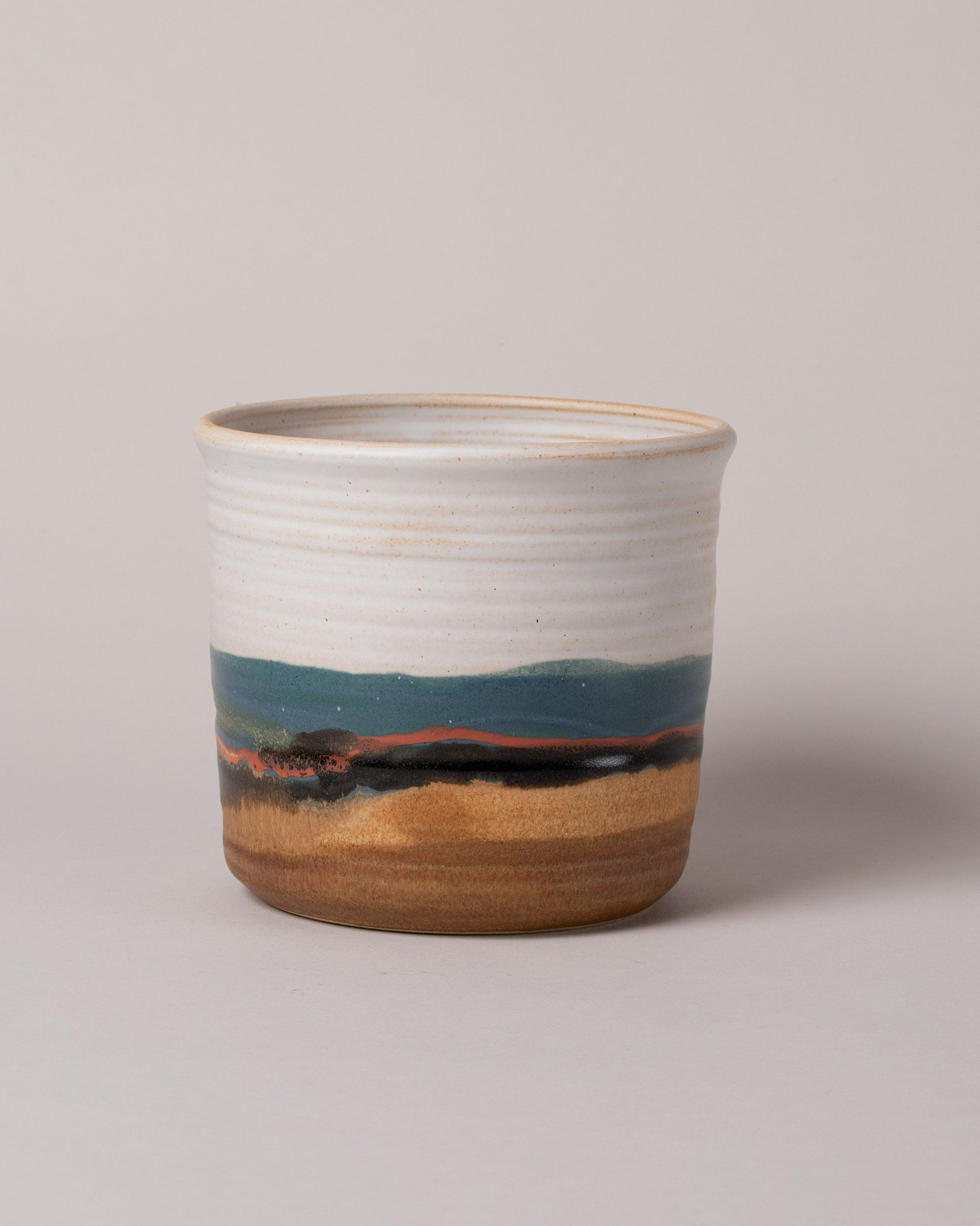 Glazed, stoneware vessel in southwestern inspired colors Handmade in Illinois, each piece of Robert Blue's Blue Eagle pottery is unique